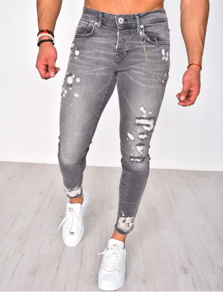 Ripped Jeans with Chain and Paint Flecks