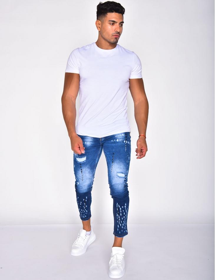 Jeans destroy à clous bicolore