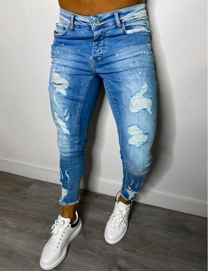 Jeans skinny destroy à taches de peinture
