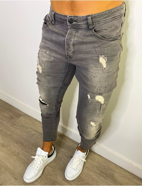 Jeans skinny destroy à tâches de peinture
