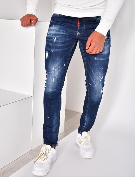 Jeans destroy à tâches de peinture
